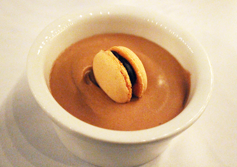 Chocolate mousse with persimmon macaron.