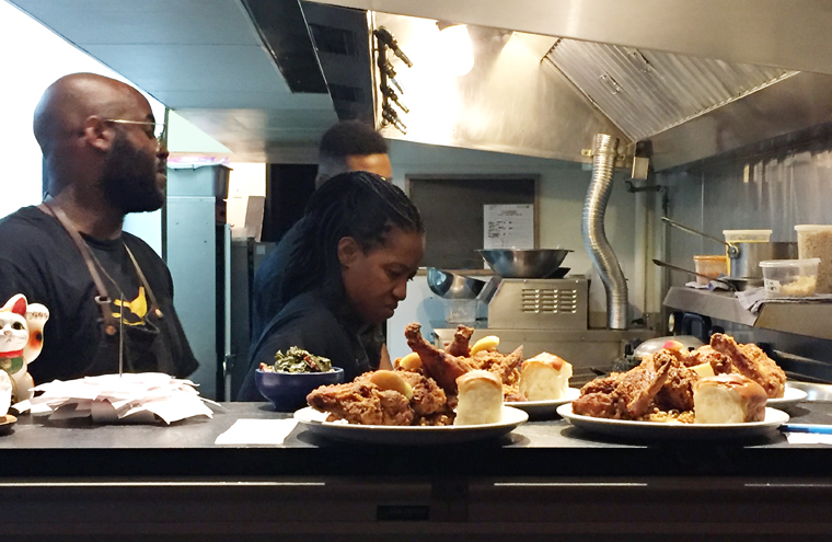 A peek into the kitchen with orders and orders of fried chicken.