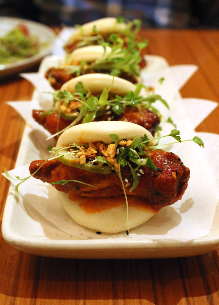 Spicy Korean-style fried chicken snuggled inside steamed buns at Cin-Cin.