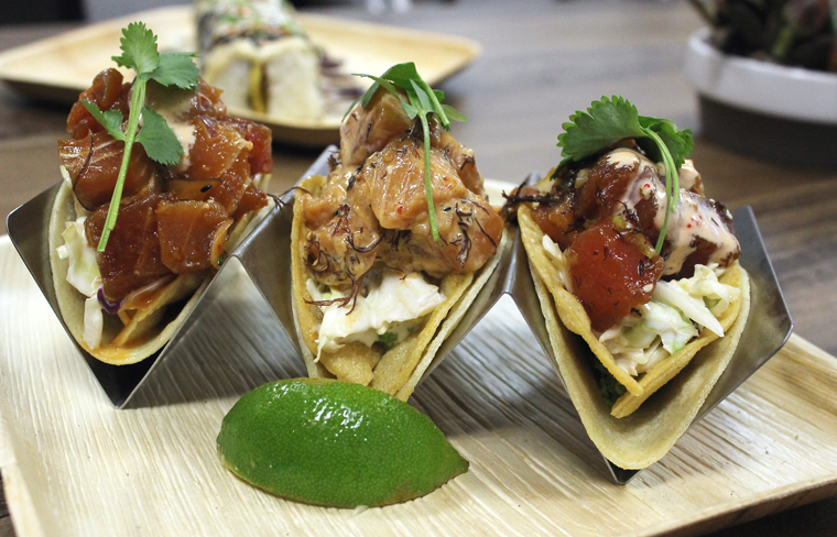 A trio of poke tacos.
