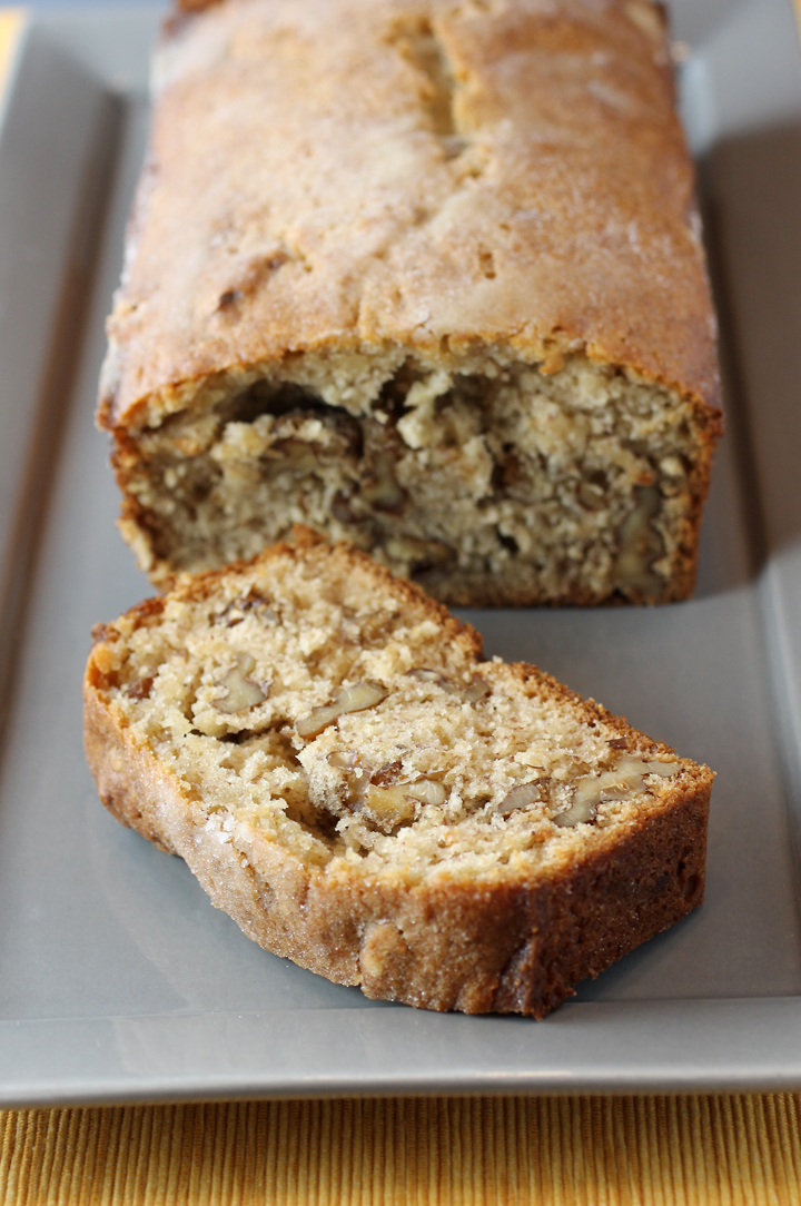 Half a stick of melted butter gets brushed on top before this banana bread gets a shower of sugar, too.