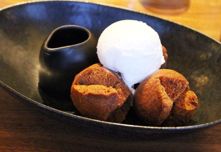 Okinawan doughnuts gussied up with ice cream and chocolate sauce.