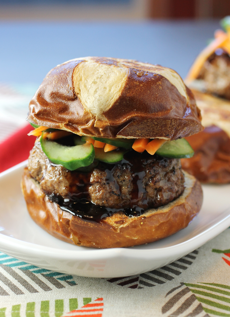 Five-spice, hoisin sauce, and quick pickled carrots and cucumbers turn this lamb burger sensational.
