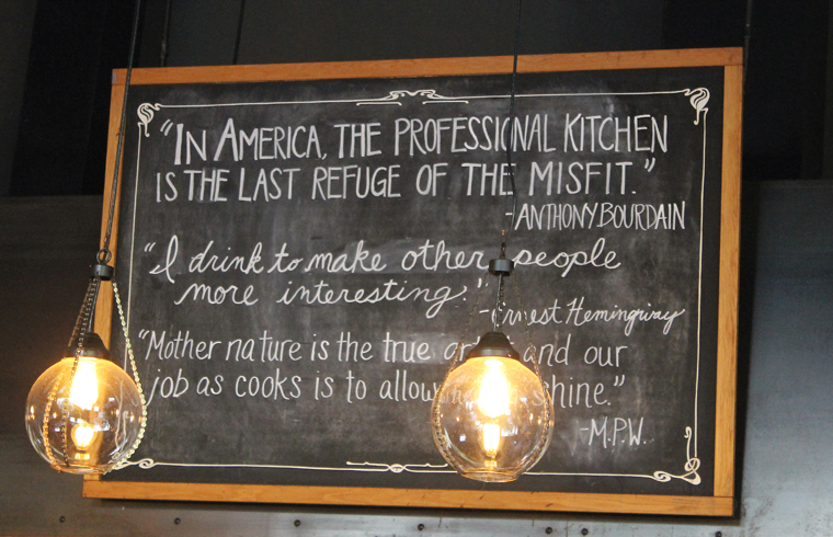 A sign above the open kitchen.