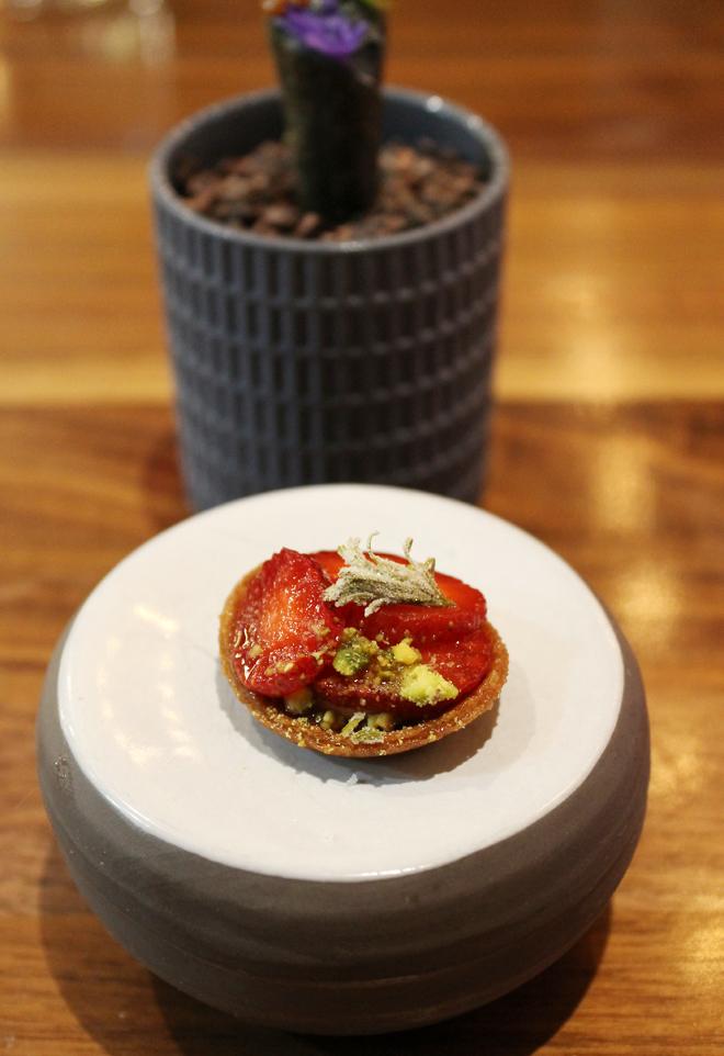 A perfect itty-bitty strawberry tart.