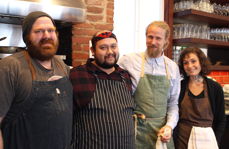 Chef Andrew Greene (far left) and chef Duncan Kwitkor (in green apron), along with their assistants.