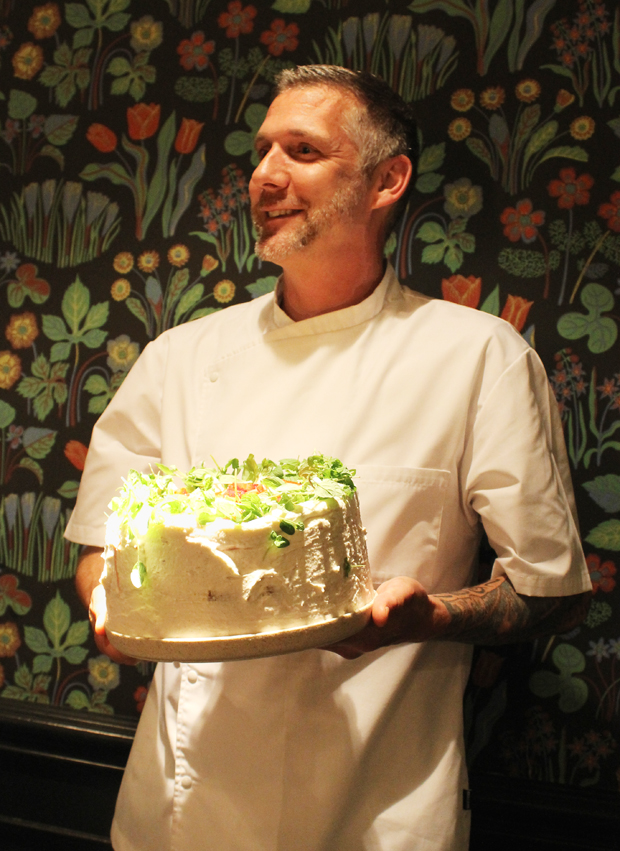 Chef Robert proudly presents his strawberry cake.