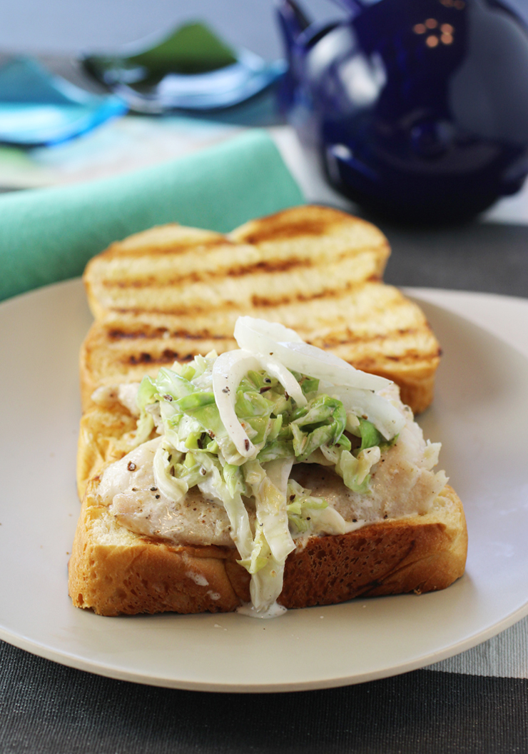 Pile on the creamy, tasty slaw on this New England fish sandwich.