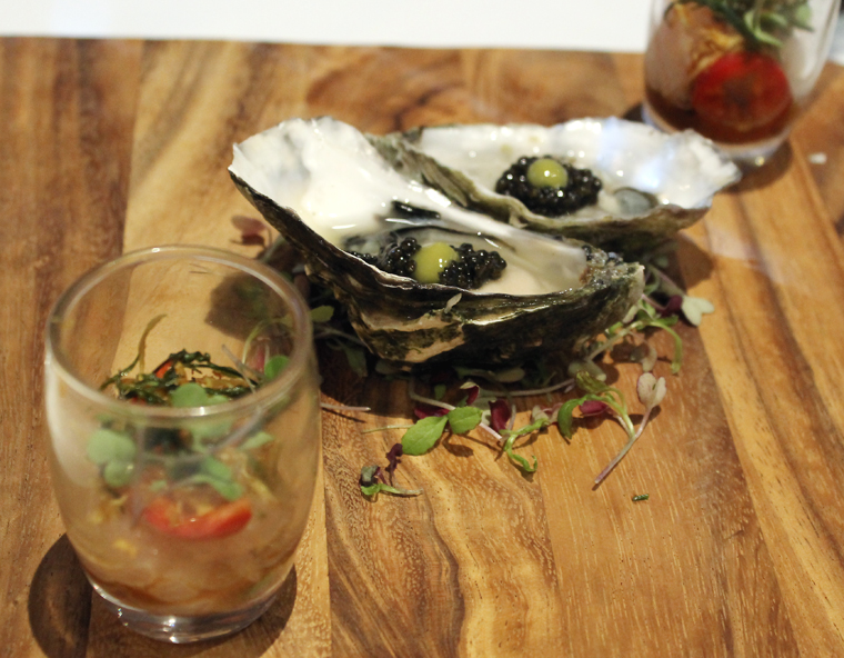 Hamachi shots and oysters on the half shell with caviar.