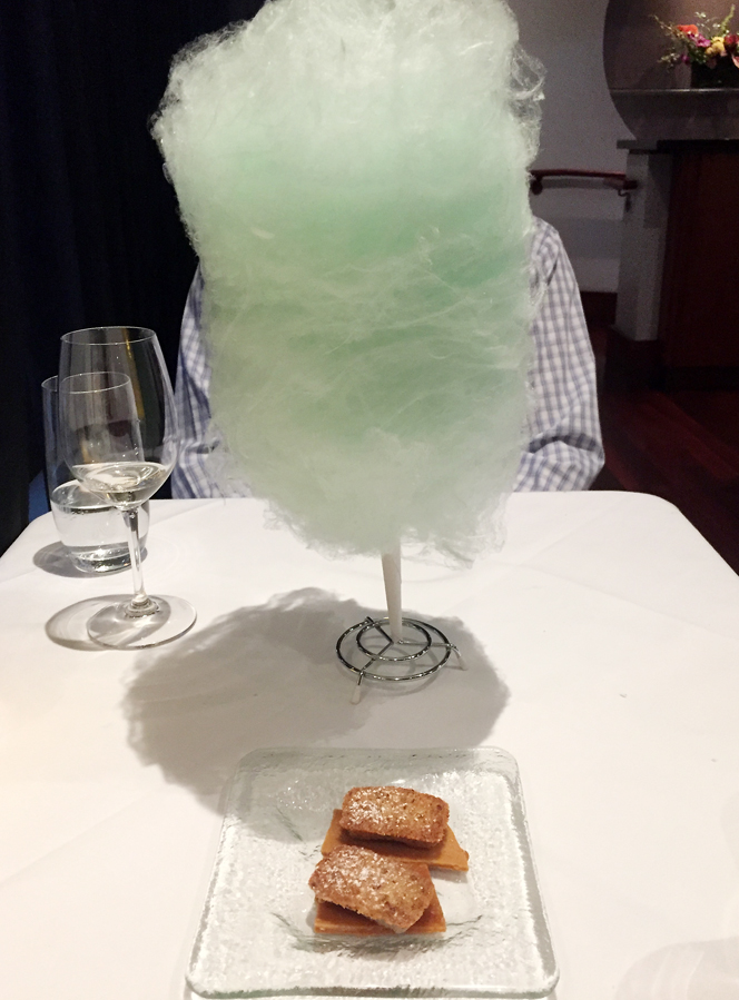 My husband doing his impersonation of a Rene Magritte painting -- only with cotton candy instead.