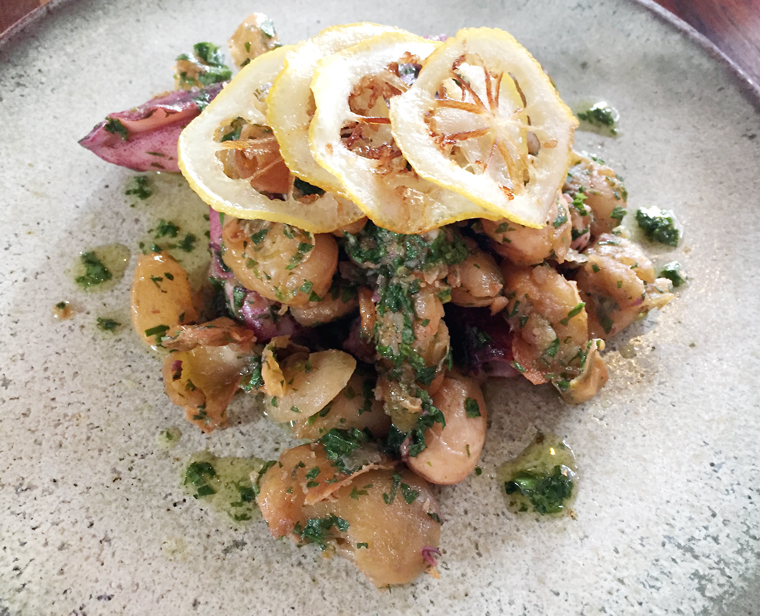 Roasted calamari with fried plump beans makes for a substantial starter.