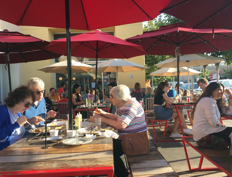 On a sunny day, the sidewalk tables fill up fast. Khan has regulars who come every week.
