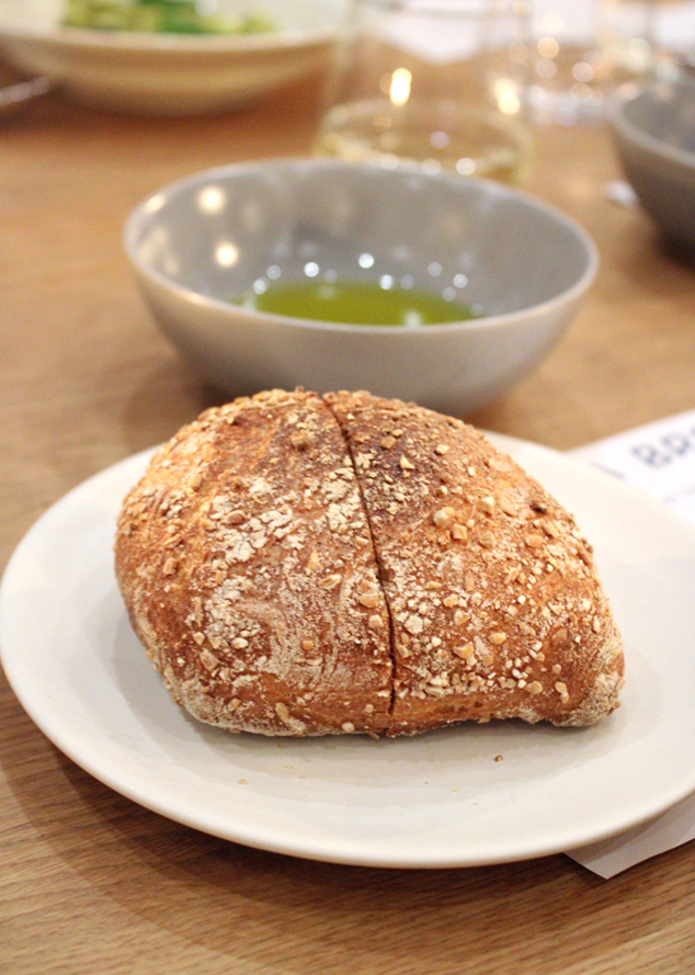Crusty, warm bread from Manresa bread with olive oil.