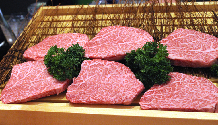 The slabs of Drunken A5 Wagyu are shown to guests before being cooked.
