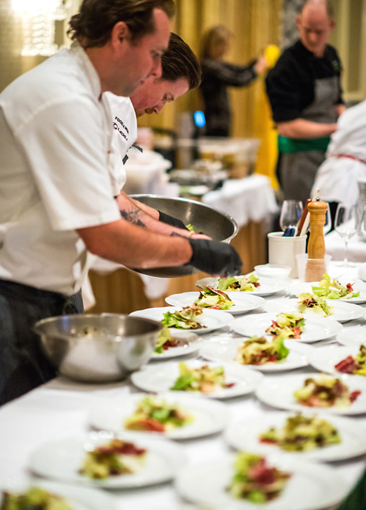 Chefs Jarad Gallagher and Peter Armellino plating at last year's Taste & Tribute. (Photo courtesy of the Tibetan Aid Project)
