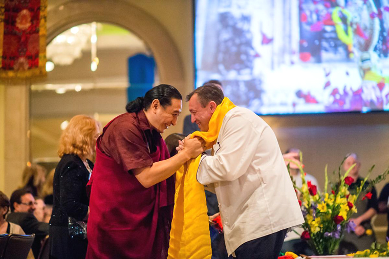 Chef Laurent Manrique receiving a Tibetan blessing.