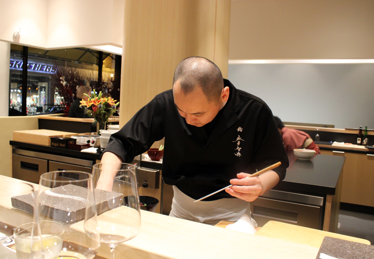 Chef Tomonori Nagai behind the sushi counter.