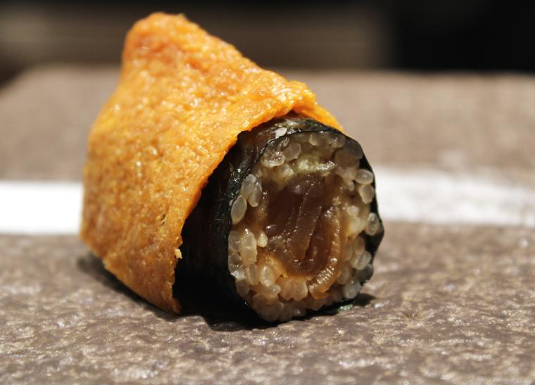Tuna roll enveloped in fried tofu skin.