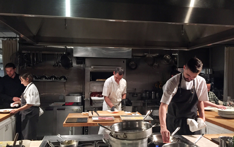 Executive Chef Kelly McCown at the center of the open kitchen.
