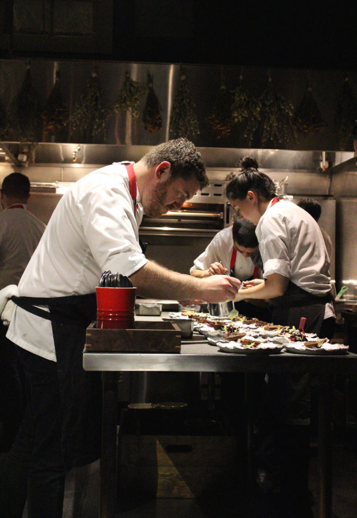 Chef David Barzelay putting the finishing touches on a dish at his Lazy Bear in San Francisco.