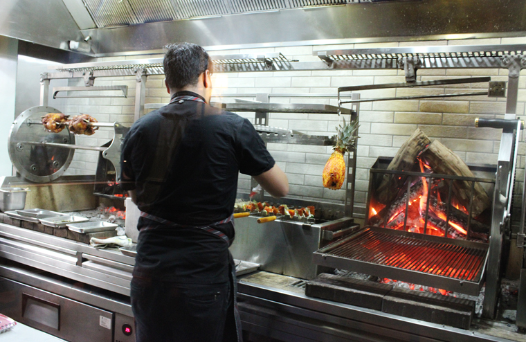 The custom grill that was fabricated in Atlanta to Chef Sarkar's specifications.