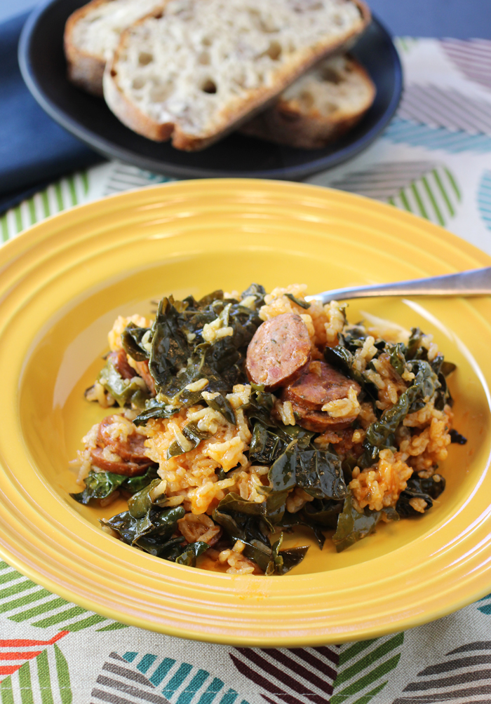 Coins of andouille sausage and tender kale leaves fortify this rice dish.