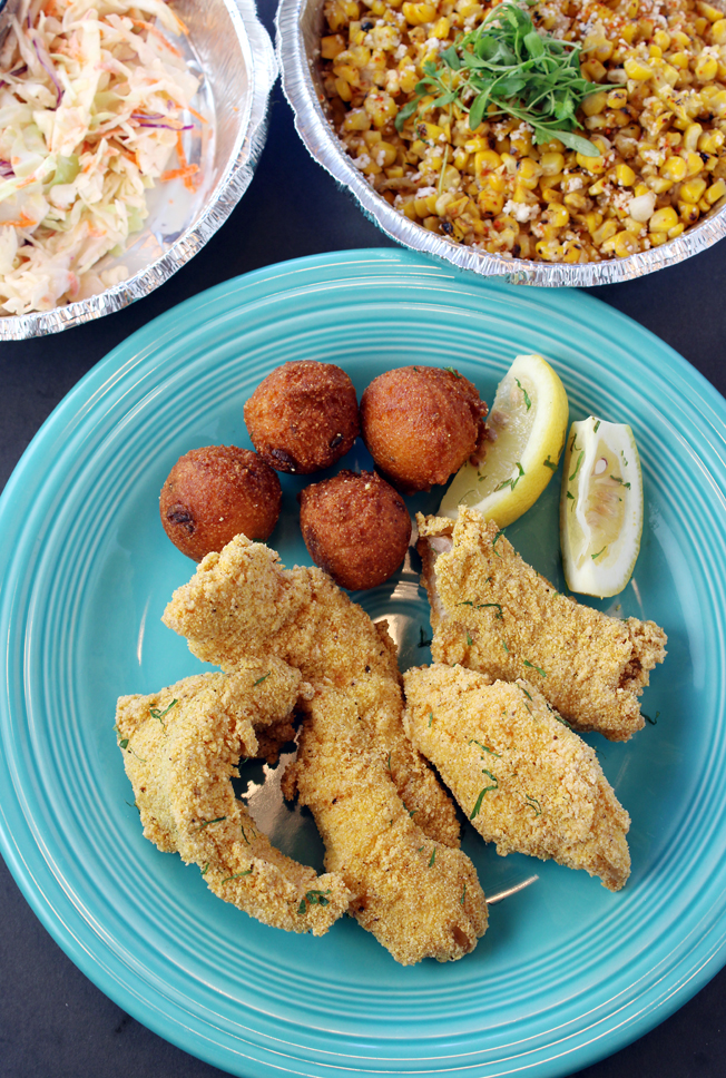 Catfish and hush puppies with cole slaw, plus a side of street corn -- all from The Table.