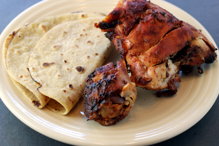 Moist, burnished chicken tandoori with freshly made roti -- all from Viks.