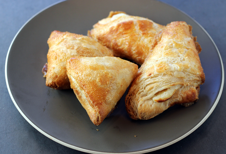 Phyllo pastries filled with mushrooms (left) and cheese (right).