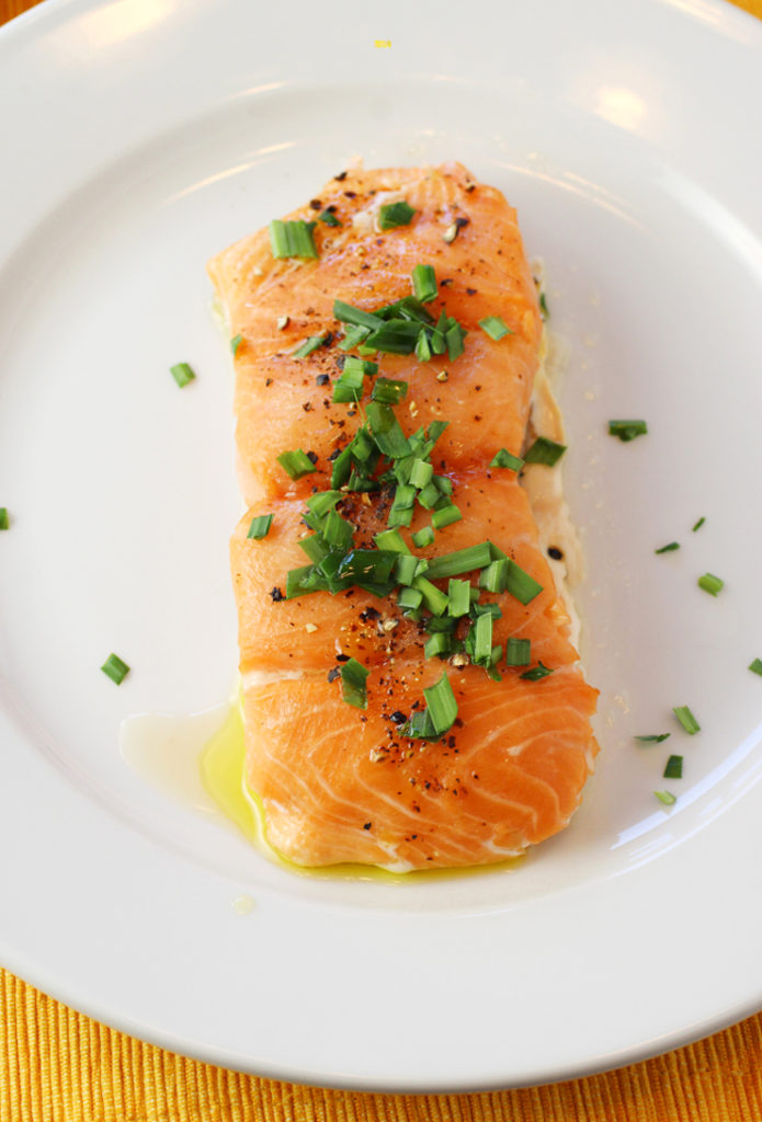 Cooked in the oven with a pan of water underneath, salmon fillets steam gently for a incredibly supple texture.
