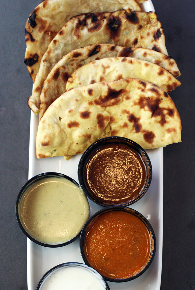 Assorted naan with dip sampler.