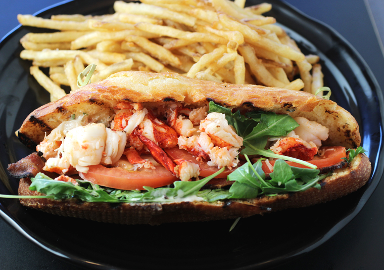 A two-handed lobster roll with truffled fries.