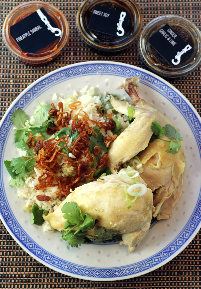"""Bird Dog's organic """"Hainanese'' chicken with three dipping sauces and jasmine rice garnished with fried shallots, green onions and cilantro."""