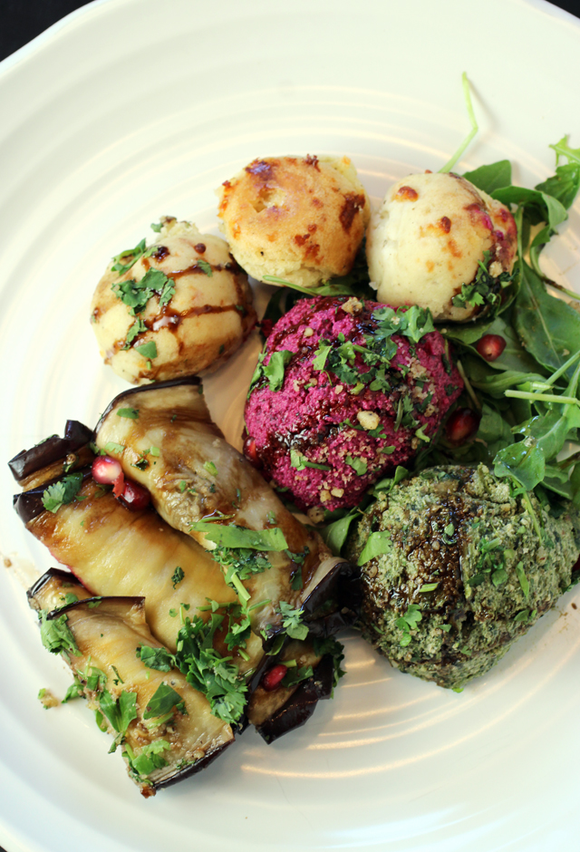 An appetizer of creamy walnut spreads and eggplant roll-ups.