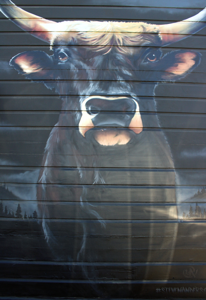 The striking mural of a bull at the front of the restaurant was created by Oakland artist Steven Anderson.