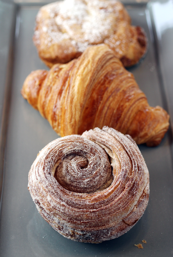 Morning bun (front), classic croissant (center), and chocolate-almond croissant (back).