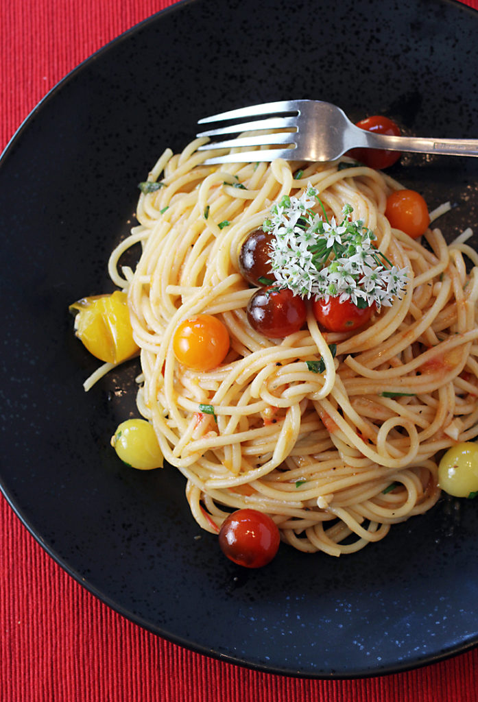 Tomatoes two ways -- grated and whole cherry ones -- are featured in this easy pasta dish.