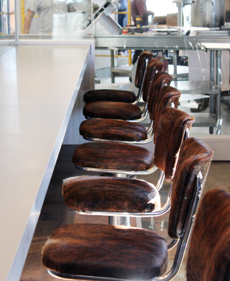 Cowhide-covered chairs at the counter.