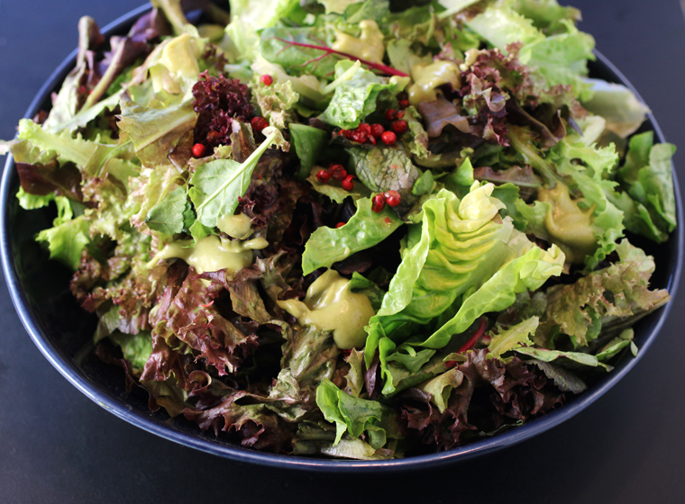 Red lettuce, mustard greens, little gem leaves with green goddess.