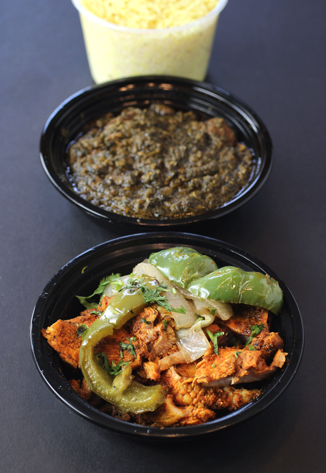 Grilled chicken boti (front), lamb with spinach (middle), and basmati rice (rear).
