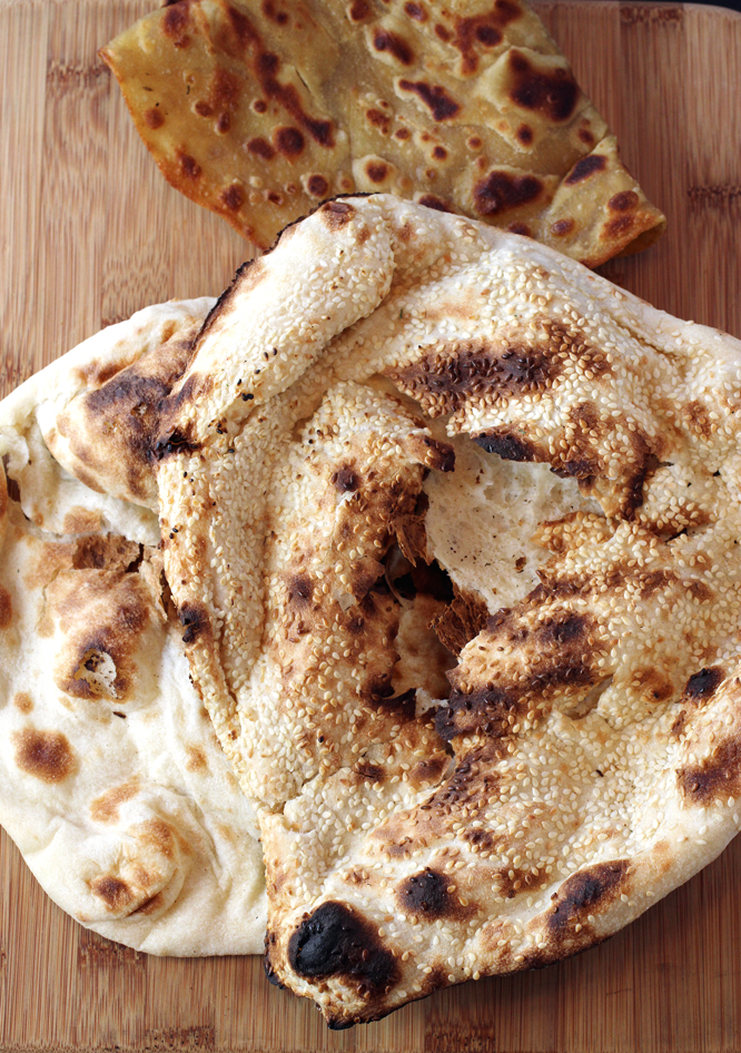 Paratha (rear), and plain and sesame naan (front).