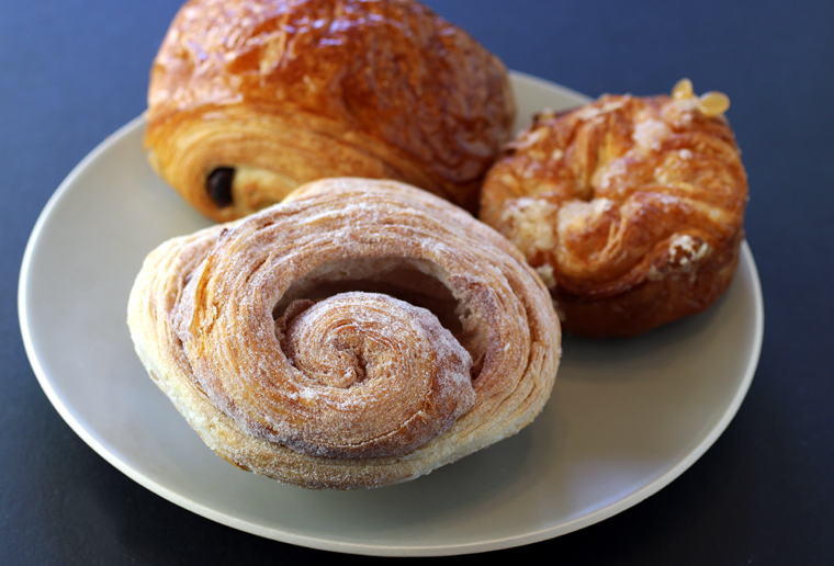 (Clockwise from left rear): Chocolate croissant, kouign-amann, and morning bun.