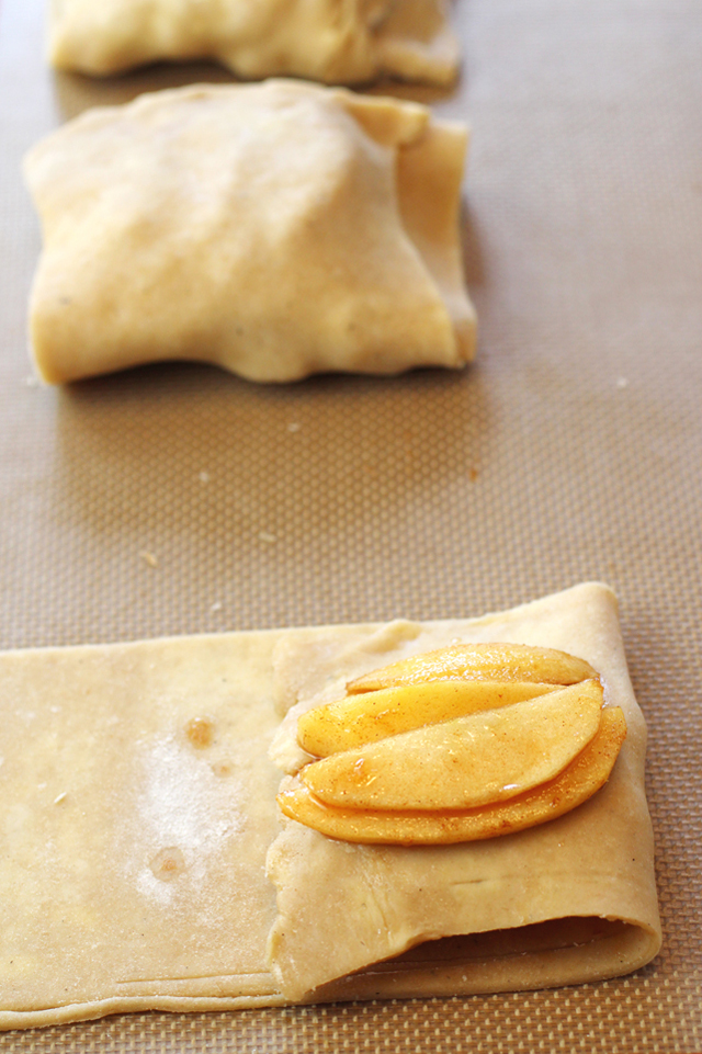 The dough gets folded over with apples three times for each wrapple.