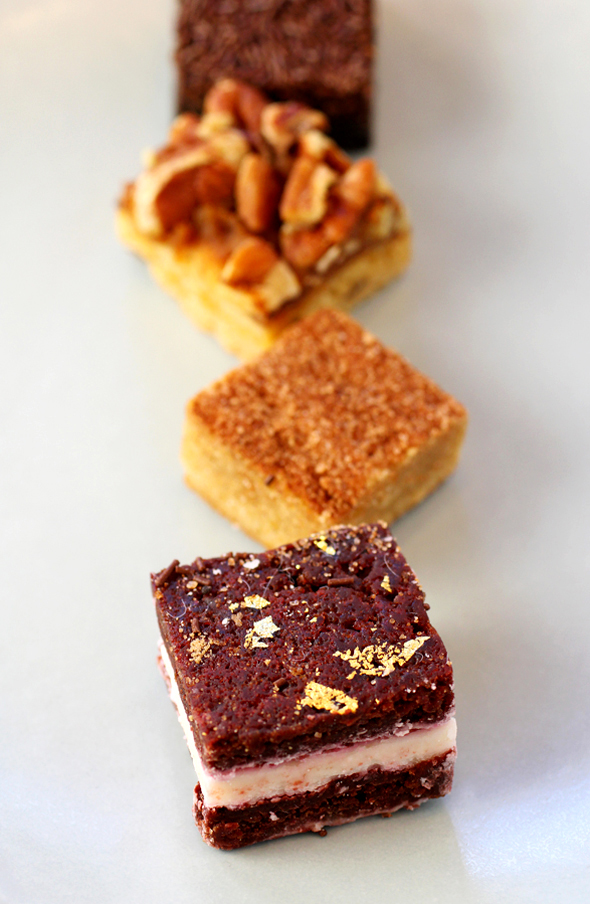 (Front to Back): The Blondery's Red Velvet, Cinnamon Sugar, Pecan and Salted Caramel, and Brooklyn Blackout blondies.