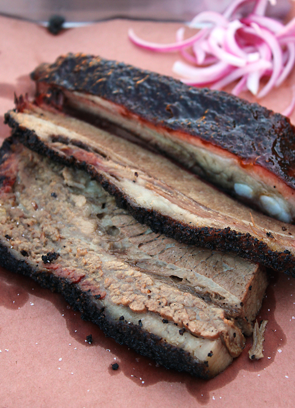 Brisket (forefront) and ribs (back) from Horn Barbecue.