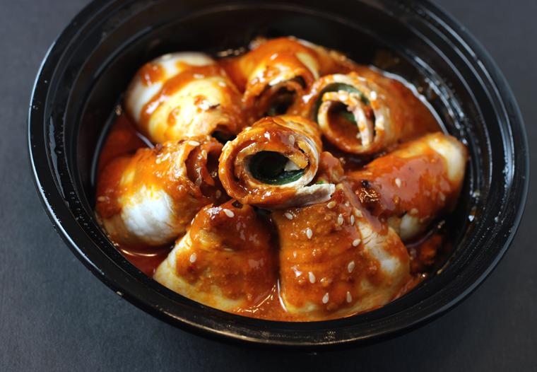 Sliced pork belly rolls in garlic sauce.