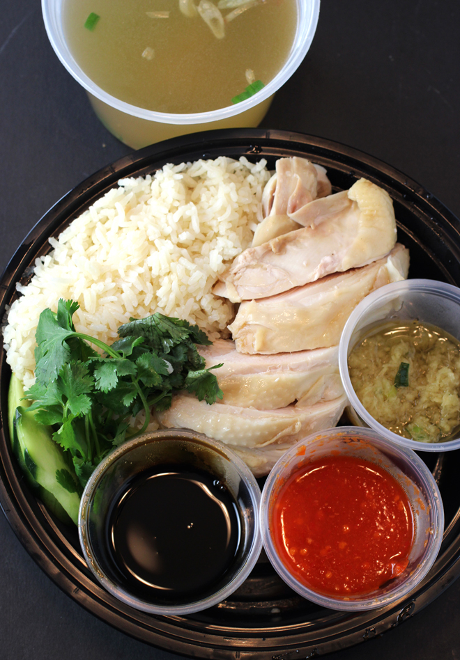 Classic Hainan chicken with rice, broth and sauces.