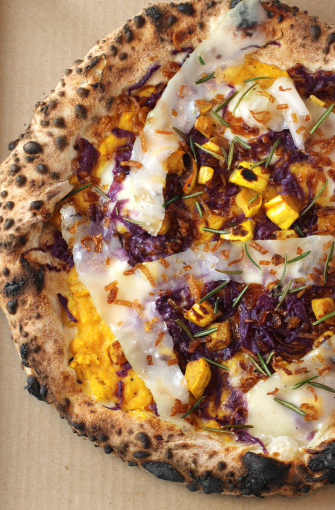 Pausa's festive pizza laden with butternut squash puree, delicata squash pieces, and fabulous lardo.