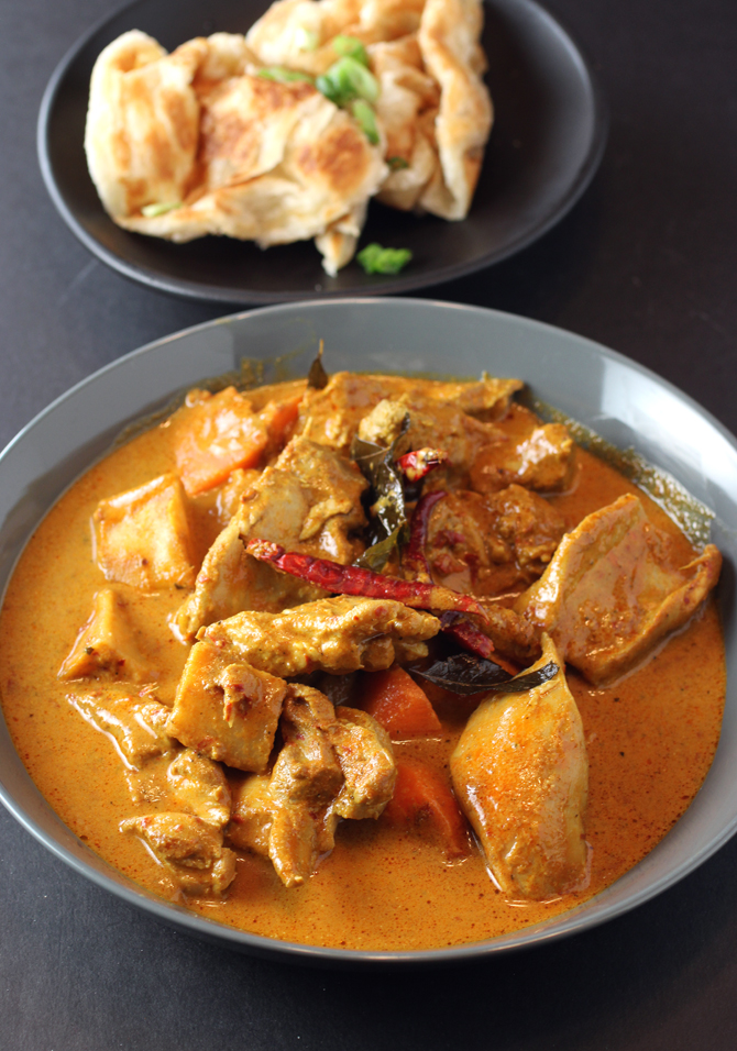 Singaporean chicken curry with a side of roti.
