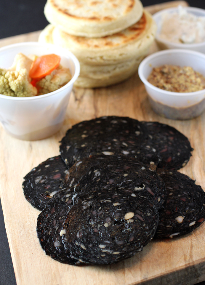 Squid-ink salame with accompaniments.